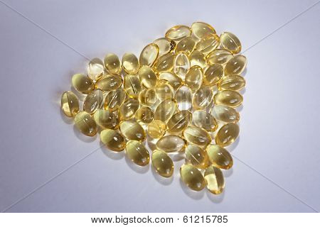 Cod Liver Oil Omega 3 Gel Capsules In The Form Of Heart Isolated On White Background
