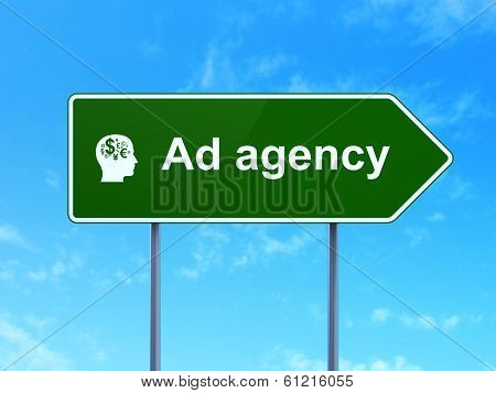 Advertising concept: Ad Agency and Head With Finance Symbol on road sign background