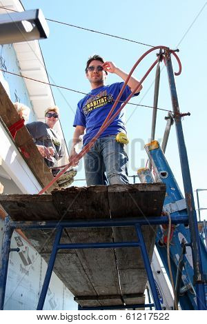 LOS ANGELES - MAR 8:  Dominic Zamprogna at the 5th Annual General Hospital Habitat for Humanity Fan Build Day at Private Location on March 8, 2014 in Lynwood, CA