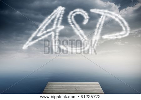 The word asp against cloudy sky over ocean