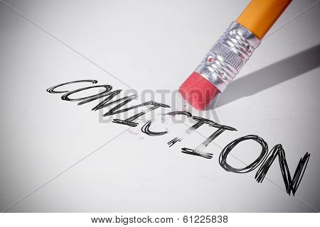 Pencil erasing the word conviction on paper