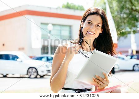 Car Sales Woman With Tablet In Trade Show