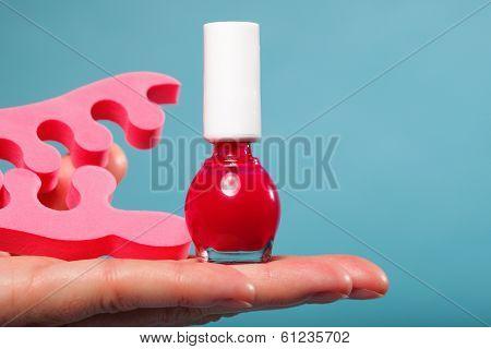 Foot Pedicure Red Nail Polish And Toe Separators