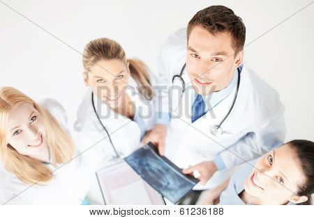 picture of young group of doctors looking at x-ray