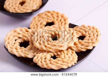 Murukku is a savoury snack from India