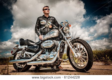 MOSCOW, RUSSIA-JULY 7, 2013: Biker on Legendary bike Harley Sportster. Harley-Davidson sustains a large brand community which keeps active through clubs, events, and a museum.