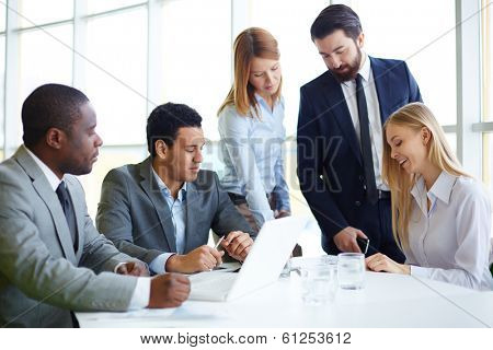 Group of business partners discussing ideas and planning work in office