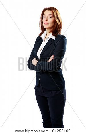 Beautiful businesswoman with arms folded looking away isolated on a white background