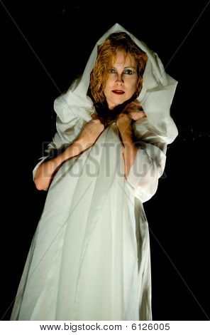 Attractive woman wrapped in a white cloth.