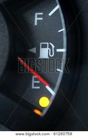 Close up of fuel gauge on empty