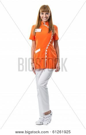 Beautiful young nurse portrait in orange work clothing
