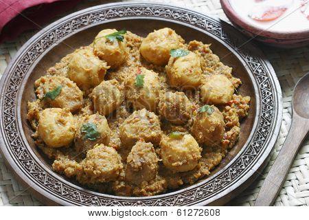 Kashmiri dum aloo is a deep fried baby potatoes cooked in yogurt