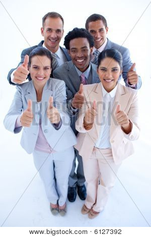 Happy Multi-ethnic Business Team With Thumbs Up