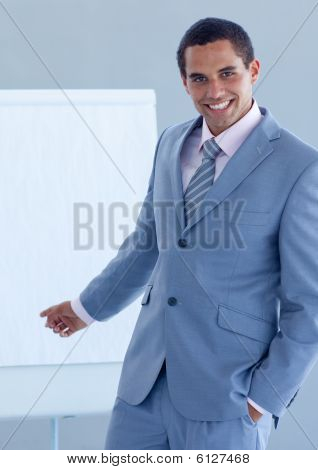 Young Businessman Pointing At A Whiteboard