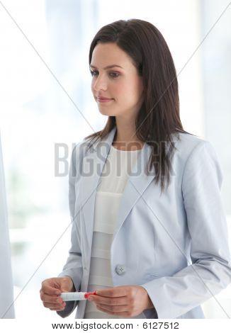 Businesswoman Listening To Her Team In A Presentation