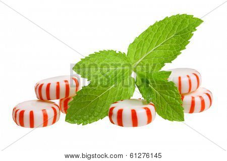 Peppermint candies and sprig of mint, cutout, isolated on white background
