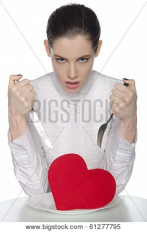 Femme Fatale Threatening Heart On A Plate