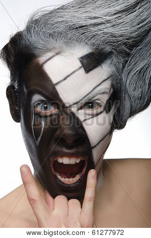 Portrait With Musical Makeup And Rock Gesture