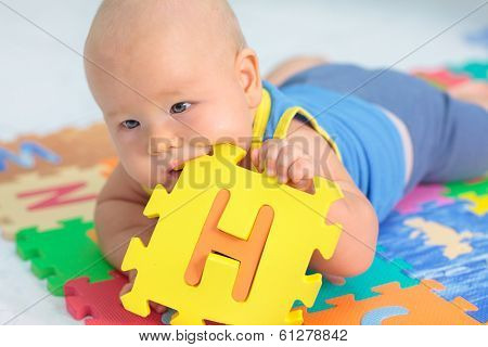 Cute baby is playing toy