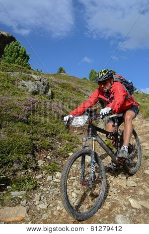 Mountain Biker Riding Though Swiss Mountain Area