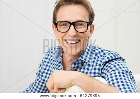 Portrait Of Happy Young Man Wearing Eyeglasses