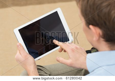 Closeup Of Person Holding Digital Tablet With Blank Screen