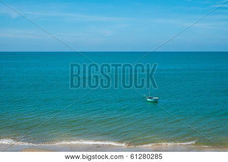 Boat Floating In Blue Sea
