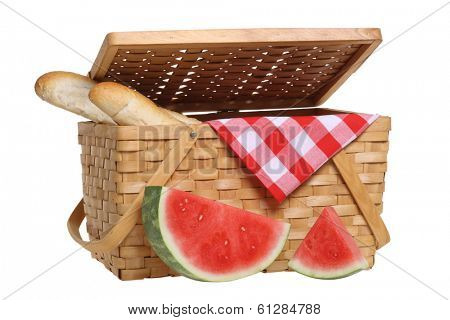 Picnic basket with watermelon and bread, cutout on white background