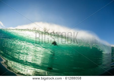 Surfer Riding Ocean Wave Swell