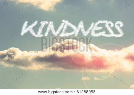 The word kindness against bright blue sky with cloud