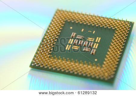 Computer CPU processor chip on green reflective background