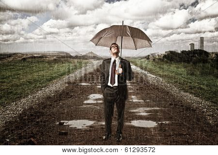 rainy day and man with umbrella on road