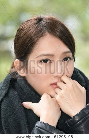Elegant Asian woman of sadness in winter drizzling days.