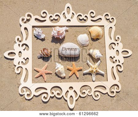 Starfishes And Seashell With Frame On The Sandy Beach