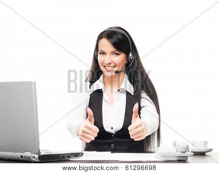 Young, confident and beautiful customer support operator working in a call center.