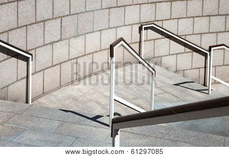 staircase with a handrail on the background wall