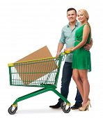 happiness,electronics, shopping and couple concept - smiling couple with shopping cart and big cardb