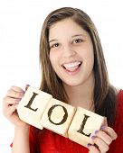 picture of lol  - A young teen laughing while holding rustic alphabet blocks with the letters LOL - JPG