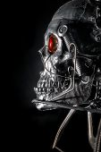 pic of cranium  - Skull of a human size robot isolated on black - JPG