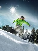 picture of snowboarding  - view of a young girl snowboarding in winter environment - JPG