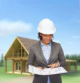 building, developing, consrtuction and architecture concept - smiling businesswoman in white helmet