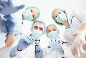 stock photo of surgical instruments  - picture of young team or group of doctors in operating room - JPG