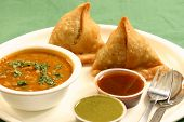 foto of samosa  - Samosa  is an Indain fried or baked pastry with a savory filling - JPG