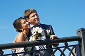 foto of fiance  - Happy bride and fiance on background blue sky - JPG