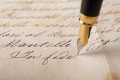 stock photo of fountains  - Fountain pen writing on an old handwritten letter - JPG
