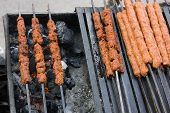 foto of kababs  - Mughlai cuisine food. It represents the cooking styles used in North India (especially Uttar Pradesh and Delhi), Pakistan, Bangladesh and the Indian city of Hyderabad