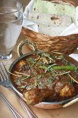 stock photo of rajasthani  - Boneless diced chicken cooked in a traditional Kadhai  - JPG