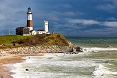 foto of lighthouse  - Landscape shot of the Montauk Point Lighthouse located at the Eastern point of Long Island - JPG