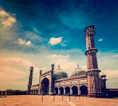 Vintage retro hipster style travel image of Jama Masjid - largest muslim mosque in India with grunge