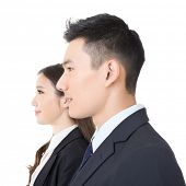 Side view of young business man and woman, closeup portrait.